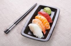 Sushi nigiri. Appetizing sushi nigiri with sticks Stock Photo