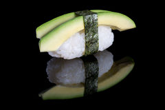 Sushi nigiri with avocado on black background with reflection. J Stock Images