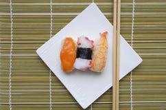 Sushi nigiri in dish with bamboo sticks Stock Photo