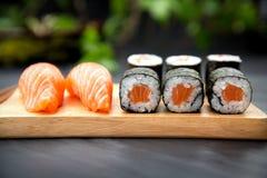 Sushi Nigiri with fresh salmon and MakiTraditional Japanese Food. Sushi Nigiri with fresh salmon and Maki roll with salmon Stock Image