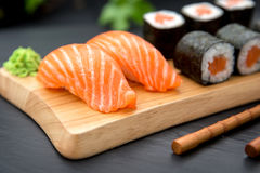 Sushi Nigiri with fresh salmon and MakiTraditional Japanese Food royalty free stock image