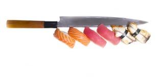 Sushi nigiri with japan knife. Isolated on white background stock photo