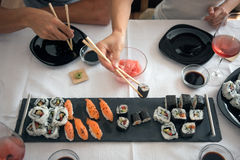 Sushi and nigiri rolls served with Japanese ginger at lunch with Royalty Free Stock Photos