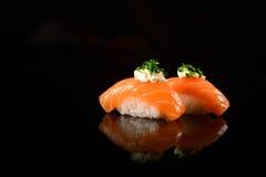 Sushi Nigiri. Salmon Sushi Nigiri on black background royalty free stock photos