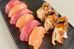 Sushi nigiri with salmon, tuna and eel. Close up of delicious sushi with fish on plate. Restaurant of seafood stock photos
