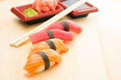 Sushi nigiri. Salmon and tuna sushi nigiri with nori ginger wasabi chopsticks and soy sauce Stock Photo