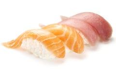 Sushi nigiri with salmon and tuna. On white background royalty free stock image