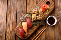 Sushi and nigiri. Set on a wooden board Royalty Free Stock Images