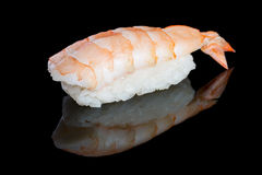 Sushi nigiri with shrimp on black background with reflection. Ja Royalty Free Stock Images