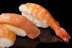 Sushi nigiri with shrimp and salmon sushi on black background with reflection. Japanese cuisine Stock Photos