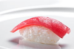 Sushi nigiri with tuna on a white background Royalty Free Stock Image