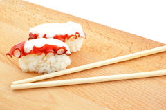 Sushi with octopus and wood chopsticks Stock Image