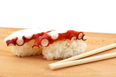 Sushi with octopus and wood chopsticks Royalty Free Stock Photography