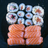 Sushi over black plate Stock Images