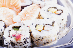 Sushi over plate Stock Images