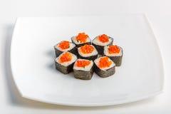 Sushi på en plätera Royaltyfri Bild