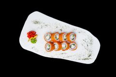 Sushi. Philadelphia roll with a cucumber, avocado, some cream cheese and salmon. Top view. Isolated on a black. Background royalty free stock photos