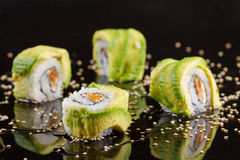 Sushi pieces on black background Stock Images