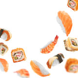 Sushi pieces flying on white background Stock Image