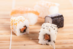 Sushi pieces on sushi mat Stock Images