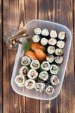 Sushi in a plastic box. Sushi set in a plastic box. Maki, uramaki and nigiri sushi stock photography