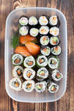 Sushi in a plastic box. Sushi set in a plastic box. Maki, uramaki and nigiri sushi royalty free stock images