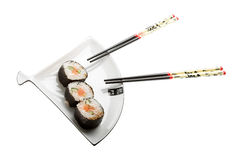 Sushi on a plate. Isolated on a white background royalty free stock image
