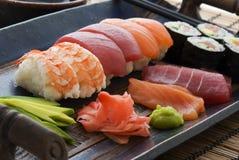 Sushi Plate. Maki, Nigiri and Sashimi Sushi on a plate well prepared Royalty Free Stock Photos