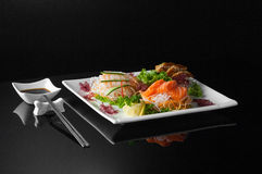 Sushi in a plate on a black background Royalty Free Stock Image