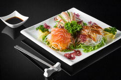 Sushi in a plate on a black background Royalty Free Stock Photos