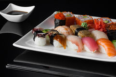 Sushi in a plate on a black background Stock Photo