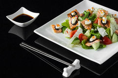 Sushi in a plate on a black background Royalty Free Stock Photo