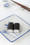 Sushi on a plate with chopstick and tea cup Stock Photo