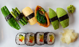 Sushi Plate. Sushi with decorations on a white plate Royalty Free Stock Photos