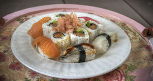 A Sushi Plate. A plate filled with different kinds of sushi Stock Image