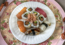 A Sushi Plate. A plate filled with different kinds of sushi Royalty Free Stock Images
