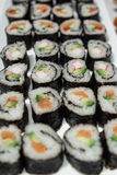 Sushi Plate. Homemade sushi, made with rice, smoked salmon or surimi, avocado and cucumber Royalty Free Stock Photos