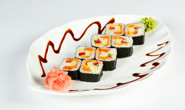 Sushi plate isolated on white. Prepared and delicious sushi taken in studio Royalty Free Stock Photos