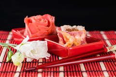 Sushi on the plate next to the ginger, chopsticks and flower Stock Image