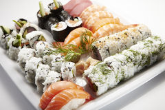 Sushi plate with nigiri, uramaki, hosomaki Stock Photos