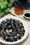 Sushi on the plate. Popular sushi japan food. Wooden rustic background. Top view.  Stock Photography