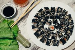 Sushi on the plate. Popular sushi japan food. Wooden rustic background. Top view.  Stock Photo
