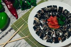 Sushi on the plate. Popular sushi japan food. Wooden rustic background. Top view.  Royalty Free Stock Photography