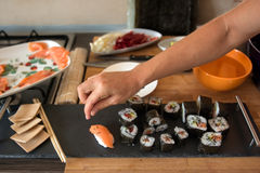 Sushi plate prepared for lunch in the domestic kitchen Stock Photography