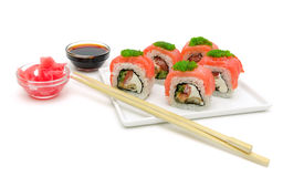 Sushi on a plate with salmon, soy sauce and pickled ginger on a Stock Photography