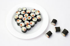 Sushi on a plate in the shape of a heart Stock Images