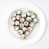 Sushi on a plate in the shape of heart Stock Image