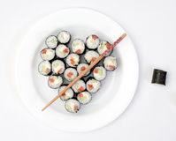 Sushi on a plate in the shape of heart Stock Photo