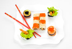 Sushi on plate with two sticks Stock Images
