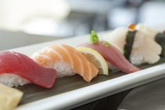 Sushi plated in a traditional plating stock images